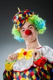 Den roliga clownen blidkar in Fotografering för Bildbyråer
