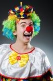 Den roliga clownen blidkar in Royaltyfri Bild