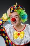 Den roliga clownen blidkar in Royaltyfri Foto