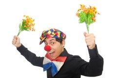 Den roliga clownen med blommor som isoleras på vit Arkivbilder
