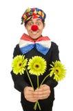 Den roliga clownen med blommor som isoleras på vit Arkivfoton