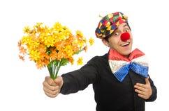 Den roliga clownen med blommor som isoleras på vit Royaltyfri Fotografi