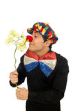 Den roliga clownen med blommor som isoleras på vit Arkivbild