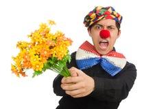 Den roliga clownen med blommor som isoleras på vit Arkivfoto