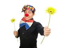 Den roliga clownen med blommor som isoleras på vit Fotografering för Bildbyråer