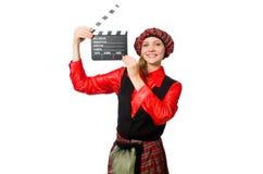 Den roliga kvinnan i skotska kläder med film Arkivfoto