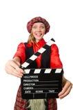 Den roliga kvinnan i skotska kläder med film Royaltyfri Bild