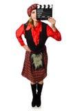 Den roliga kvinnan i skotska kläder med film Royaltyfria Foton