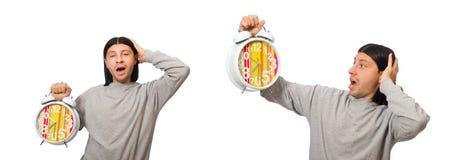 Den roliga mannen med klockan som isoleras p? vit fotografering för bildbyråer