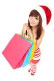 Den roliga santa kvinnan med paketerar Royaltyfri Foto