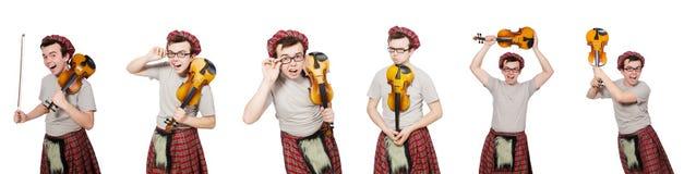 Den roliga scotsmanen med fiolen på vit royaltyfria foton
