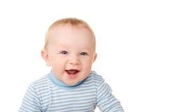 Den roliga ståenden av att skratta behandla som ett barn pojken Arkivbild