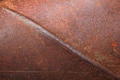 Den rostiga texturen på stålyttersida arkivbilder