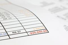 In den roten Abbildungen in den Schulden Lizenzfreies Stockfoto