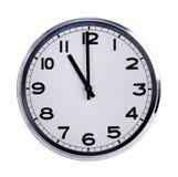 Den runda kontorsklockan visar elva klockan Royaltyfri Fotografi