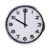 Den runda kontorsklockan visar tio klockan Royaltyfri Bild