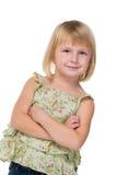 Den säkra lilla flickan ser framåtriktat arkivfoto