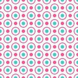 Den sömlösa geometriska modellen med ljusa rosa färger och blått pricker och cirklar Arkivfoton