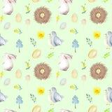 Den sömlösa modellen med vattenfärgpåskkaniner, fågelreden, ägg, fåglar, guling och gräsplan förgrena sig Royaltyfri Foto