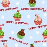 Den sömlösa vektormodellen med julmuffin, muffin, den söta kakan på blått belägger med tegel bakgrund Arkivfoton