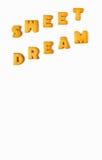 Den SÖTA DRÖMMEN för ordet som stavades med alfabet, formade kex på vit bakgrund, med fritt utrymme för design Royaltyfria Bilder