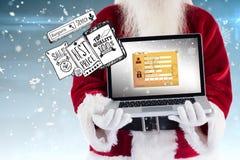 Den sammansatta bilden av Santa Claus framlägger en bärbar dator Fotografering för Bildbyråer