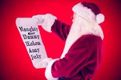 Den sammansatta bilden av Santa Claus läser en lista Royaltyfri Fotografi