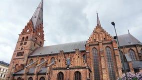 Den Sankt Petri kyrkaen är en stor kyrka i Malmö som den byggs i den gotiska stilen, och har en 105 meter det 344 ft högväxta to Arkivbilder
