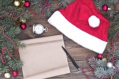 Den Santa Claus hatten på tabellen, Ñ-hristmas bläddrar Royaltyfri Fotografi