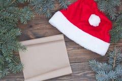 Den Santa Claus hatten på tabellen, Ñ-hristmas bläddrar Royaltyfria Foton