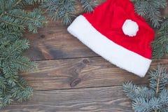 Den Santa Claus hatten på tabellen, Ñ-hristmas bläddrar Arkivbild