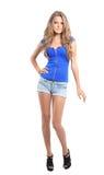 Den sexiga blonda damen i blått klär isolerat på vit Arkivfoton