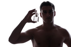 Den sexiga mannen med flaskan av doft Royaltyfri Fotografi