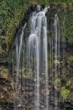 Den Sgwd år Eiravattenfallet, Brecon leder nationalparken, Wales royaltyfria bilder