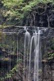 Den Sgwd år Eiravattenfallet, Brecon leder nationalparken, Wales royaltyfria foton