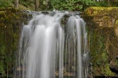 Den Sgwd år Eiravattenfallet, Brecon leder nationalparken, Wales royaltyfri bild