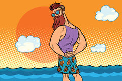 Den skäggiga hipsteren vilar på havet Arkivbild