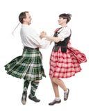Den skotska dansen för parkvinna- och mandans Arkivbilder