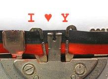Den skriftliga skrivmaskinen ÄLSKAR JAG DIG med hjärta Arkivfoto