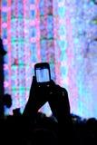 Den smarta telefonen och konserten Royaltyfria Foton