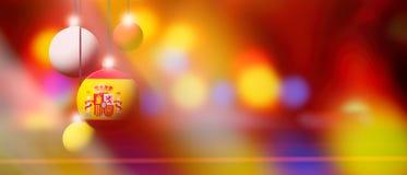 Den Spanien flaggan på jul klumpa ihop sig med suddig och abstrakt bakgrund Royaltyfria Bilder