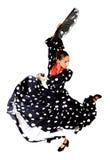 Den spanska kvinnan som dansar Sevillanas den bärande fanen, och typisk folksvart med vita prickar klär royaltyfria bilder