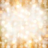 Den Sparkling guld- juldeltagaren tänder bakgrund royaltyfri foto