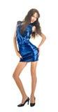 Den spensliga flickan i den blåa klänningen Royaltyfria Foton