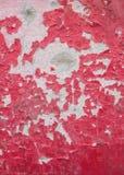 Den spruckna röda målarfärgen Royaltyfria Foton