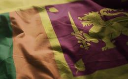 Den Sri Lanka flaggan rufsade till upp nära fotografering för bildbyråer