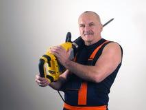 Den starka arbetaren med stansmaskinen Royaltyfri Foto