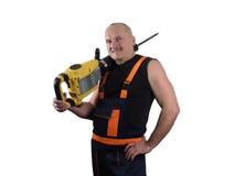 Den starka arbetaren med stansmaskinen Arkivfoto