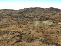 Den steniga terrängen med ett litet belopp av sand Royaltyfri Foto