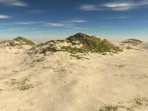 Den steniga terrängen som täckas med sand Arkivbild